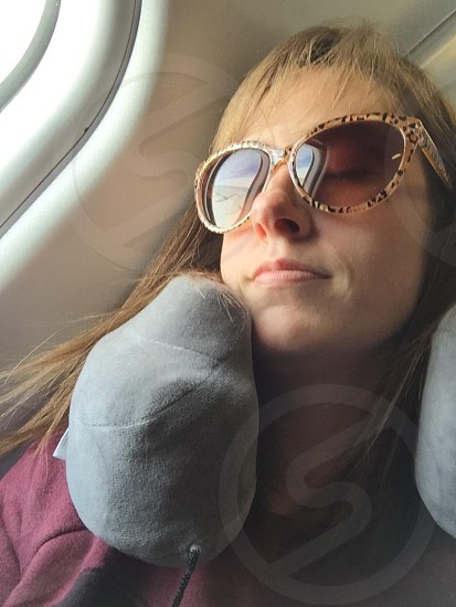 Travel sleeping airplane flight woman  photo