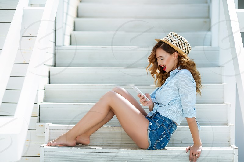 White staircase with beautiful girl photo