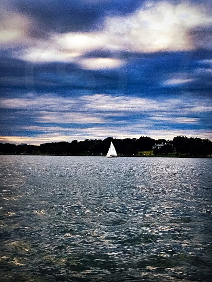 sailing boat on sea near island photo