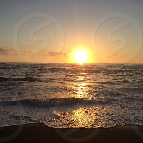 A beautiful sunset on the pacific coast  photo