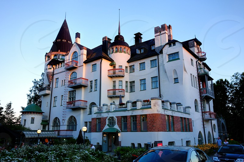 Imatran Valtionhotelli hotel in the evening light on 17 July 2015. Imatran Valtionhotelli located right by the Imatra rapids is the main landmark of the city of Imatra.  photo