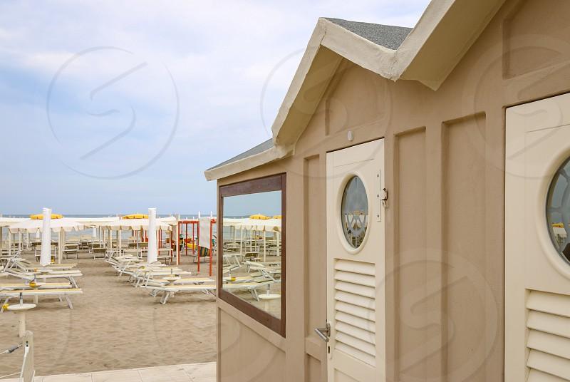 Beige beach cabin on the beach Italy Riccione photo