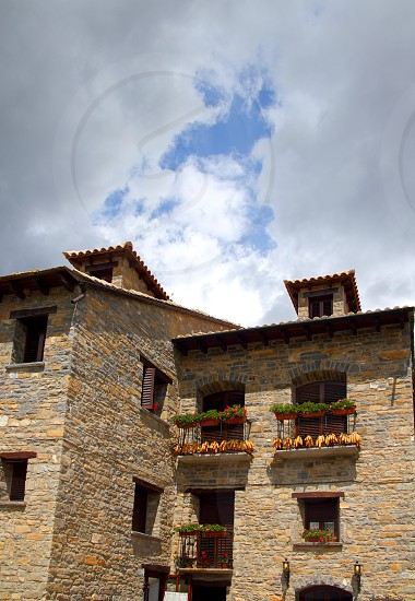 Ainsa medieval romanesque village streets in Huesca Aragon Pyrenees spain photo