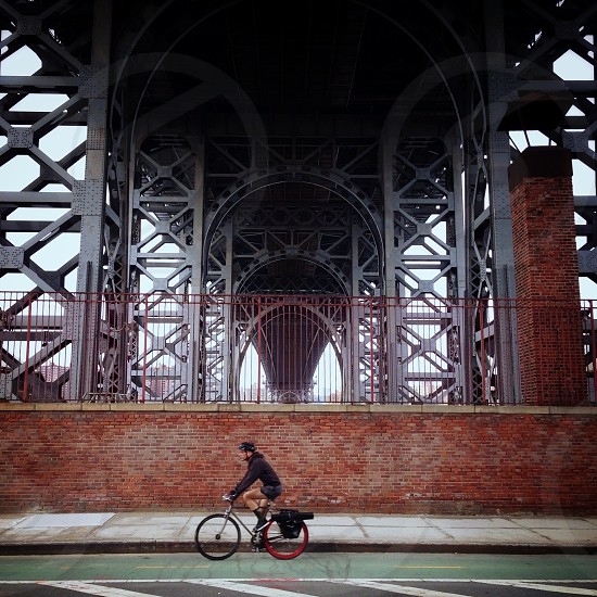 man riding fixed gear bicycle photo