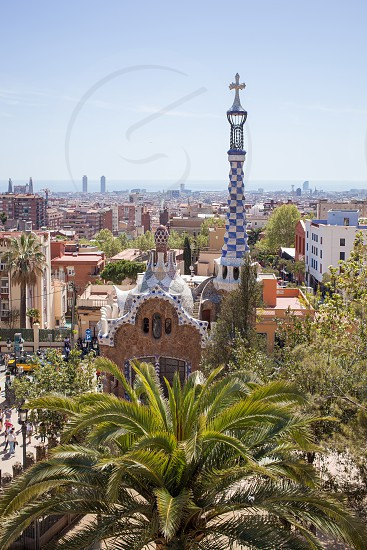 Gatehouse at the main entrance to Park Guell which were originally designed as the caretaker's house. Barcelona Spain. photo
