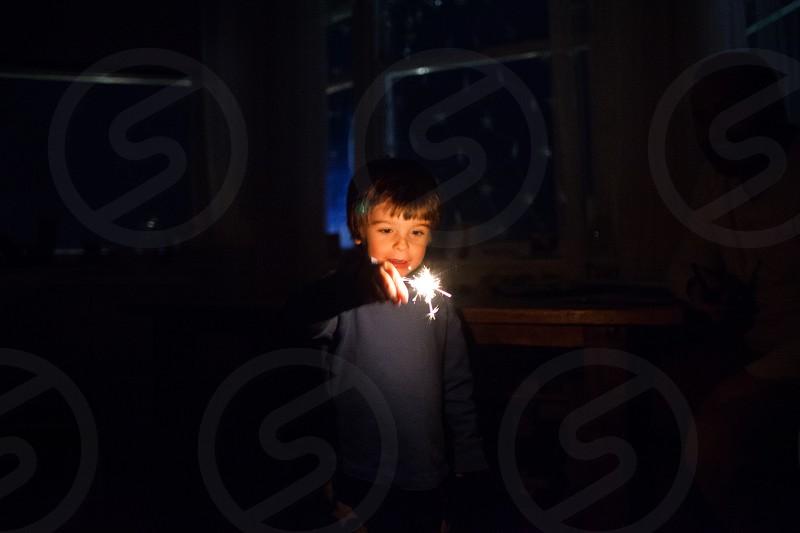 sparkler kid boy child NYE fireworks indoor light new year's new year's eve firework sparkle photo