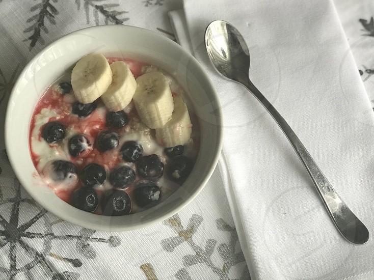 Snacking healthy eating healthy banana berries yogurt oatmeal fruit snacks photo