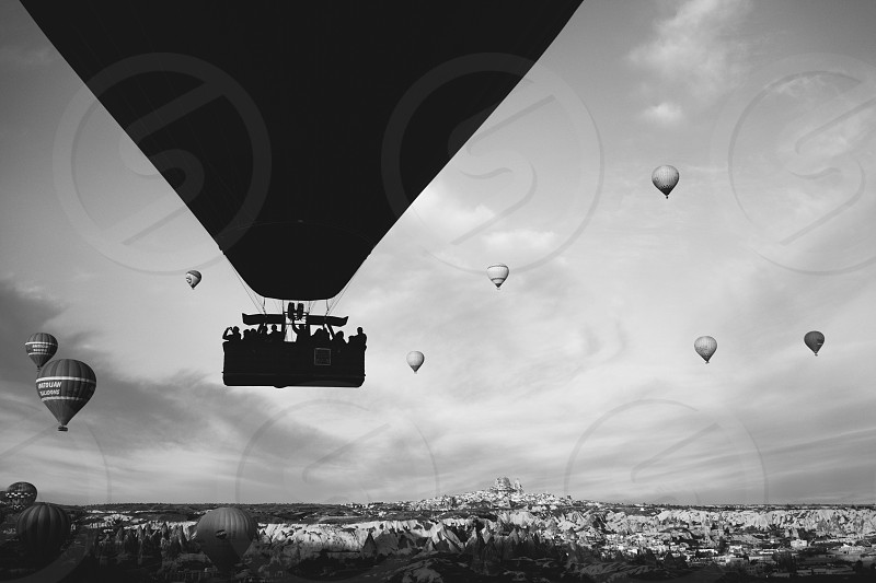 hot air balloons flying in gray scale photography photo