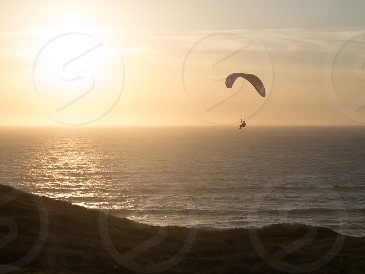 ParaglidingLanscapeflyingseadevonuk photo