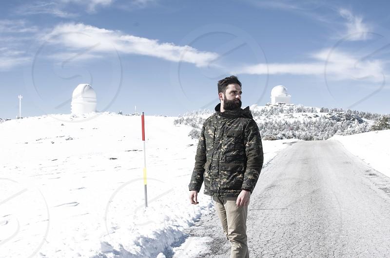A bearded young man posing in a snowy landscape in Calar Alto Sierra de los Filabres Almeria Spain photo