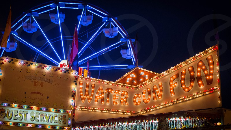 night photo of themed park photo