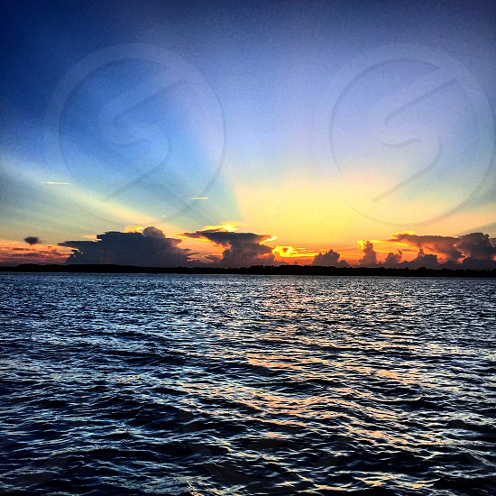 """""""See you tomorrow"""" water ocean clouds sunsets sunset boat day photo"""