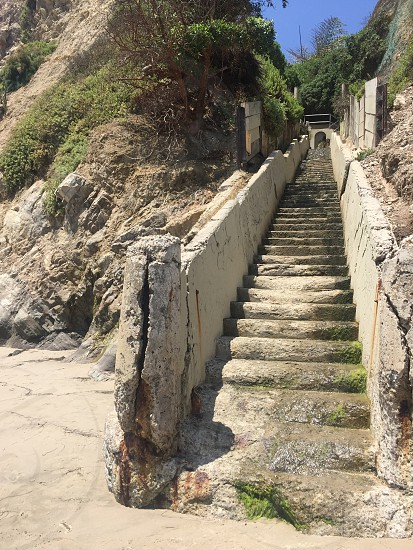 Stairs heading down to the ocean.  photo