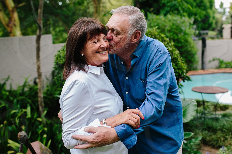 mature couple spending time at home together photo