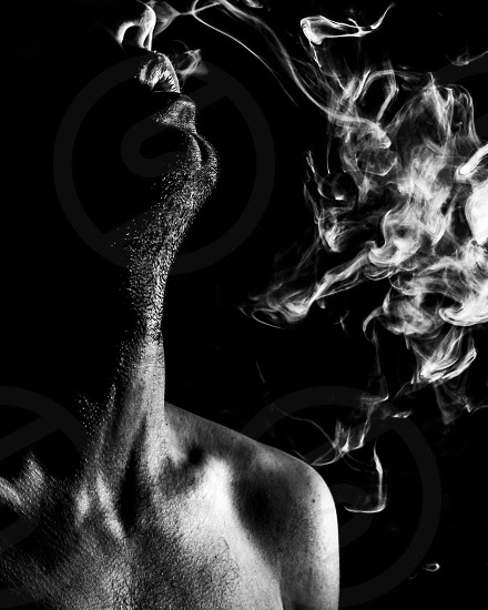 black and white low key vape exhale self portrait photo