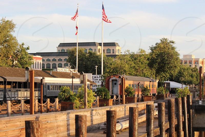 two American Flags near brown train photo