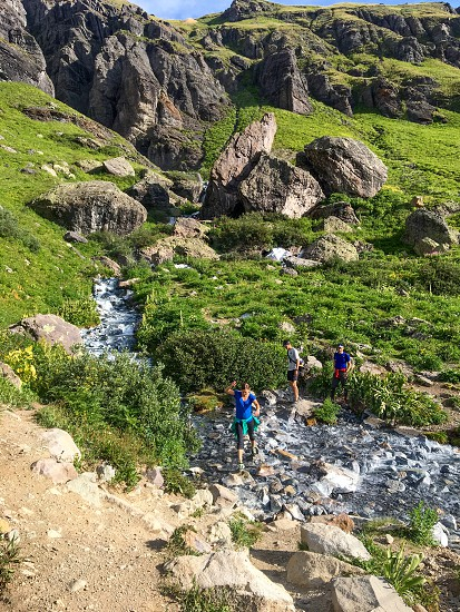 Stream crossing in the mountains photo