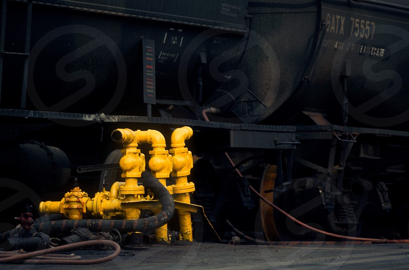 railroad tank cars fuel filler pipes industrial photo