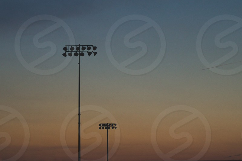 Stadium lights dusk sunset simple photo
