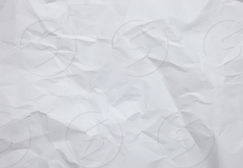Abstract white crinkle paper background with textures photo