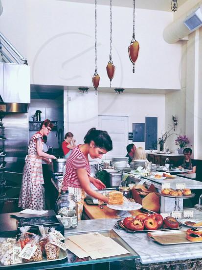 Women preparing food in cafe restaurant upscale trendy.  photo