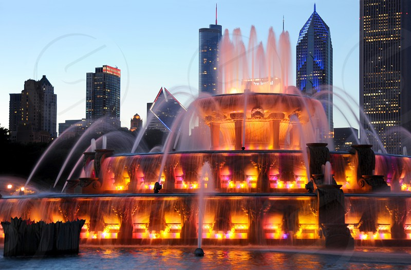 Fountain water park Buckingham Chicago twilight sunset blue red gold golden color colors colorful sky skyscraper skyscrapers building buildings skyline city cityscape city view view amazing tourist tourism flow flowing glow glowing park center central gathering photo