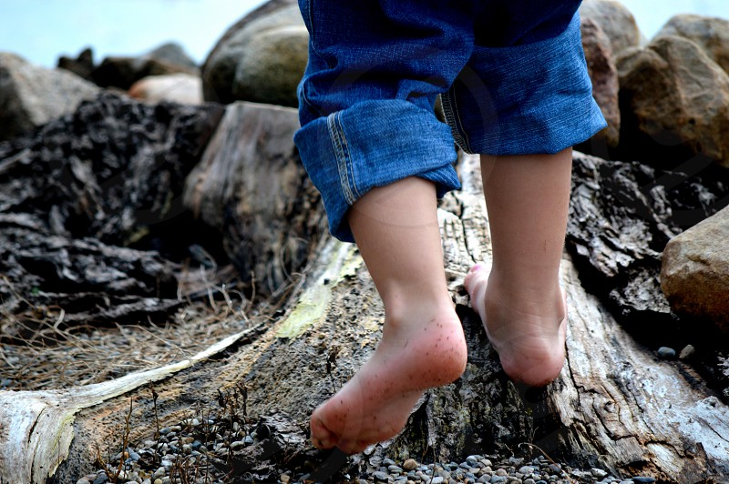 The tender bare feet of youth beginning the journey of a lifetime. photo