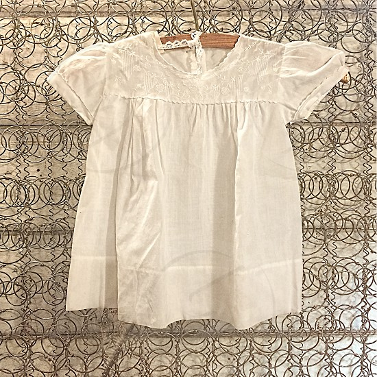 Small old-fashioned vintage child's dress photo