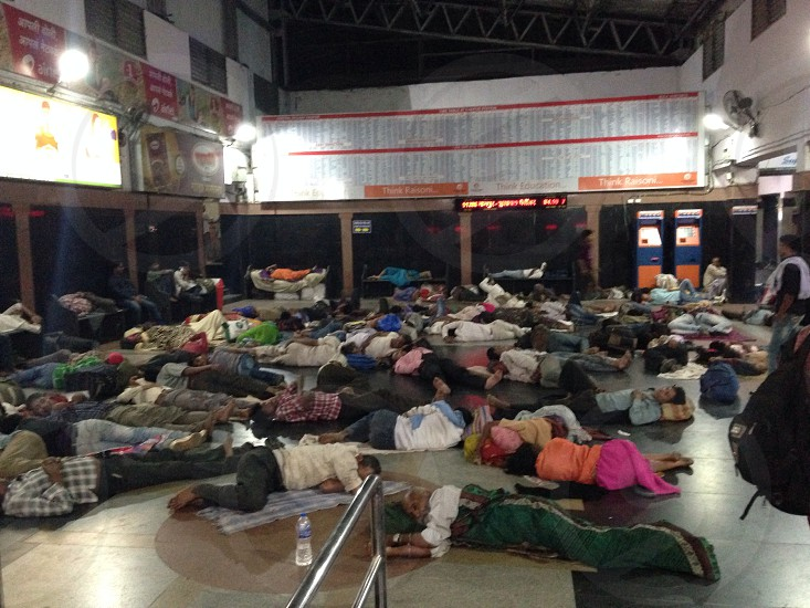 People sleeping at a train station in India photo