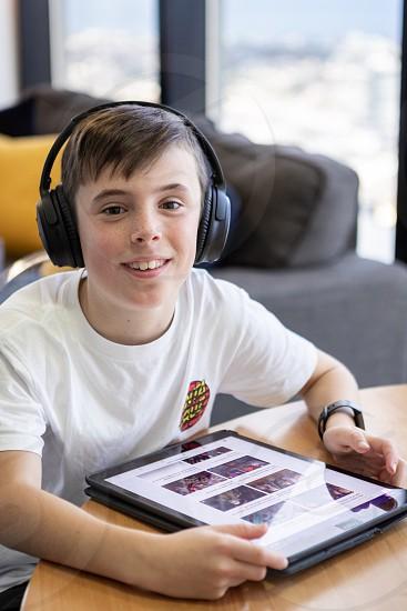 Boy technology tablet iPad headphones youth photo