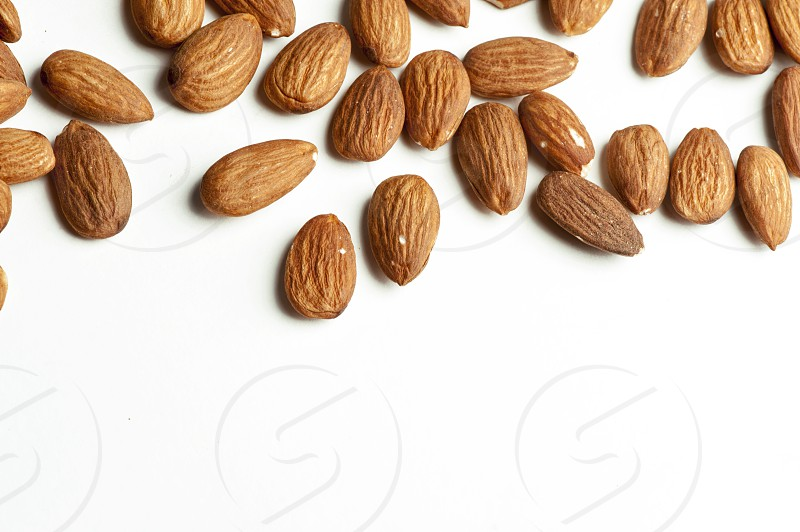 Almonds with isolated white background photo