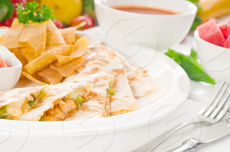 original Mexican quesadilla de pollo with nachos  served with gazpacho soup and watermelon with fresh vegetables on backgroundMORE DELICIOUS FOOD ON PORTFOLIO photo