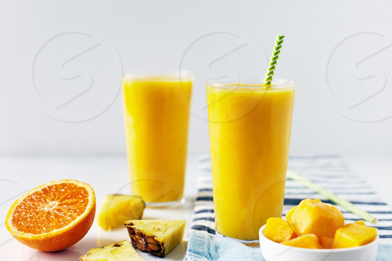 Healthy orange breakfast/snack smoothie made from oranges pineapple and mango. photo