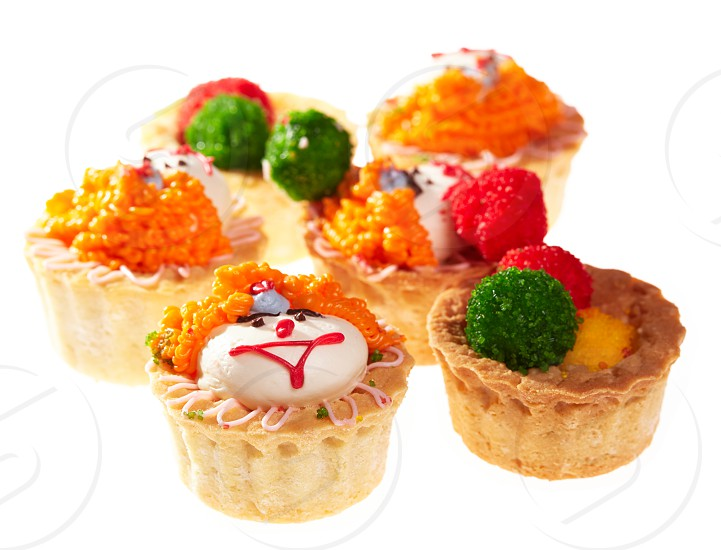 Cupcakes with smiley faces isolated on white. photo