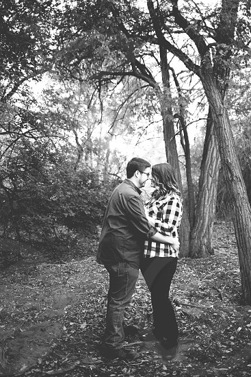 Young couple in the woods  photo