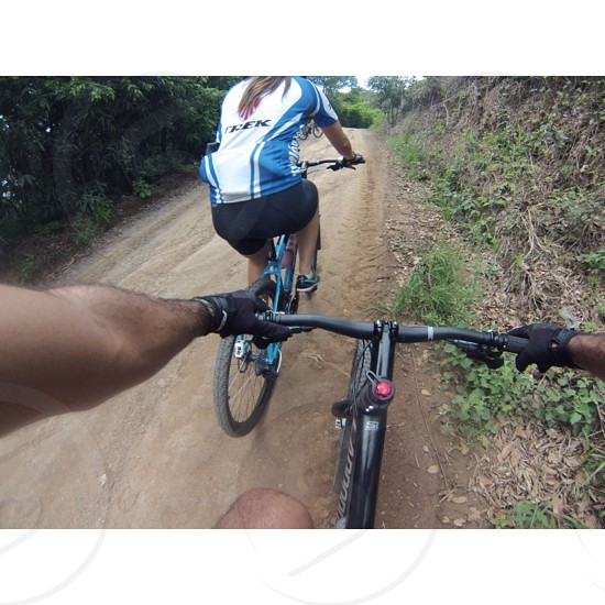 people riding bicycles photo