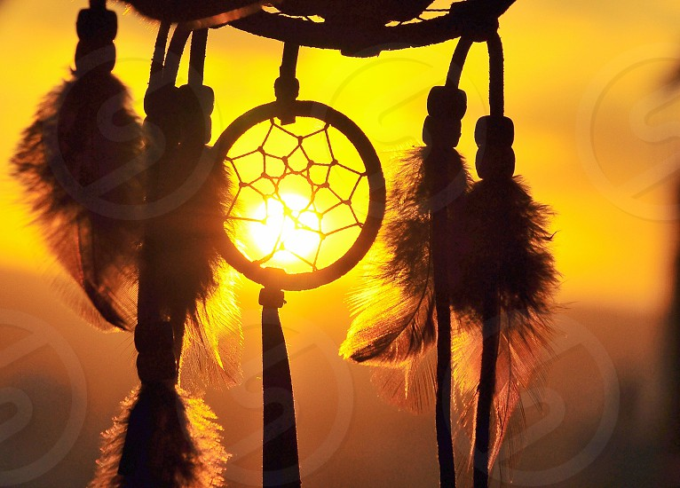 dreamcatcher on a sunset view photo