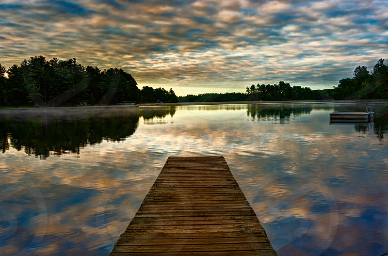 sea wooden docks lake and trees photo