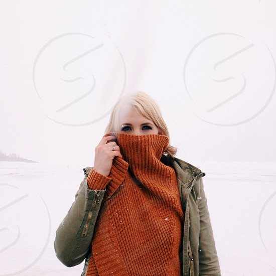 woman covering face with brown shirt photo