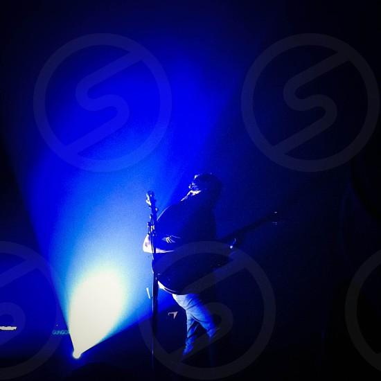 musician playing guitar silhouette blue light photo
