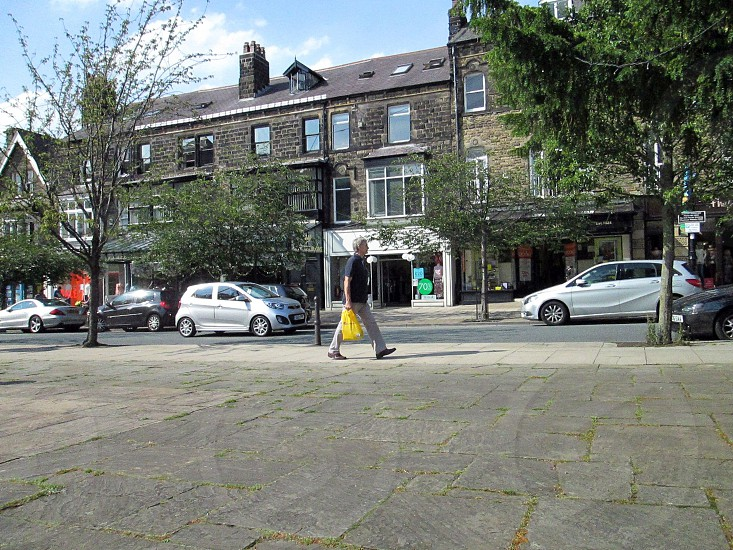 UK. ENGLAND. WEST YORKSHIRE. Ilkley. The Grove one of the main shopping areas of the town. photo