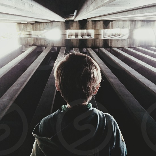 boy standing inside the building photo