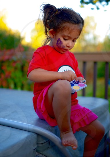 A mYoung mind enjoying the fun of experimenting with paint.  photo