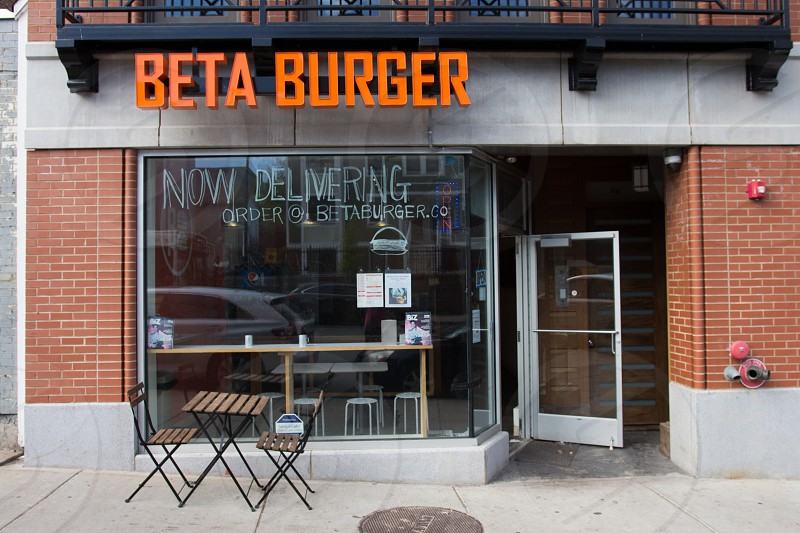 beta burger restaurant in front of brown wooden tables during daytime photo