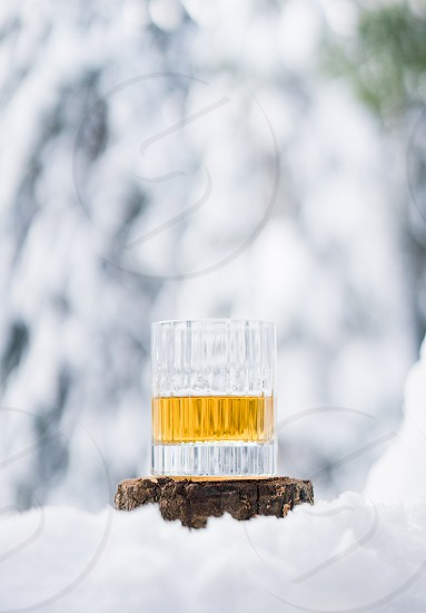 whiskey glass tumbler snow forest cabin alcohol drink cold photo