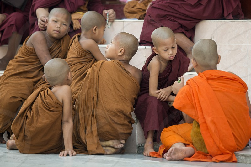 young monks in the Shwedagon Paya Pagoda in the City of Yangon in Myanmar in Southeastasia. photo