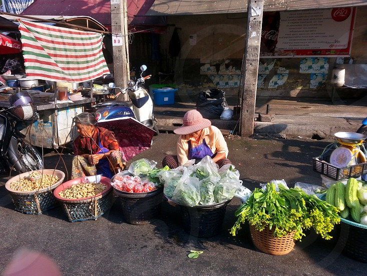 woman selling vegetables during daytime photo