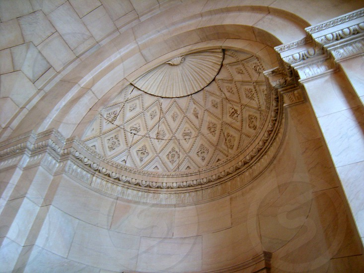 Inside of arched marble alcove photo