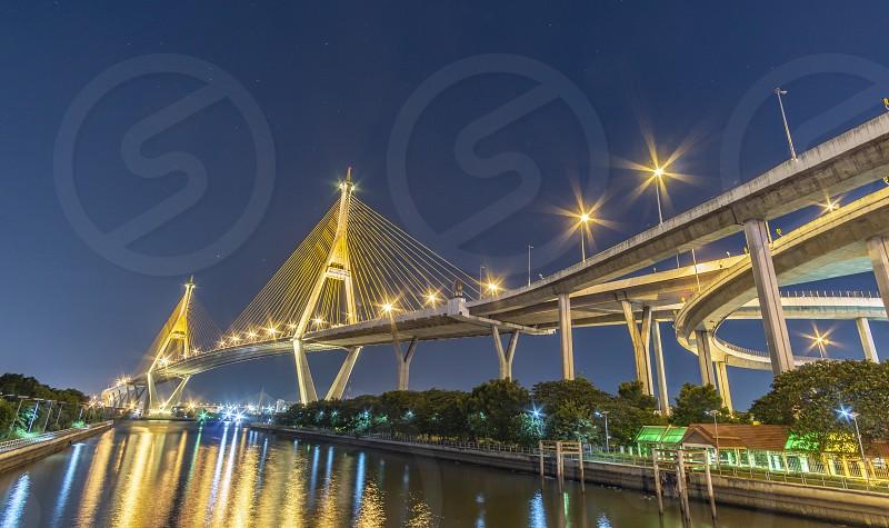 Bhumibol Bridge Chao Phraya River Bridge. Turn on the lights in many colors at night. photo