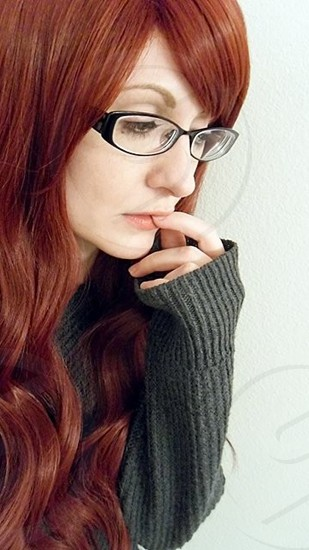 woman in gray knit sweater with black framed eyeglasses photo
